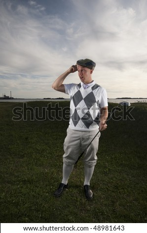 stock-photo-funny-photograph-of-a-golfer-looking-after-his-missing-ball-48981643.jpg