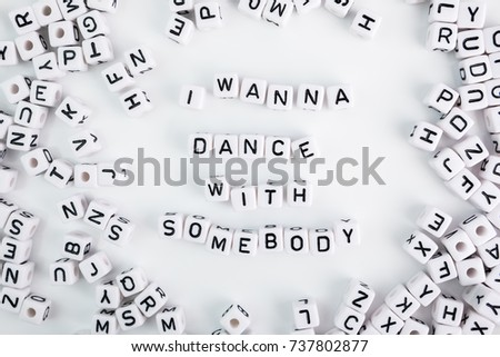 Funny phrase I wanna dance with somebody on white background made of white plastic cubes. Horizontal composition. a series of conceptual phrases and words. #737802877