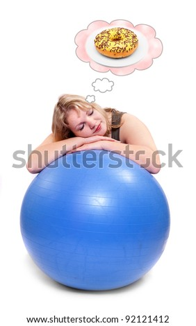 Funny picture of a hungry overweight woman dreaming on ball. Health care concept.
