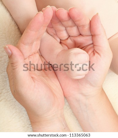 Funny picture of mothers and baby hands.
