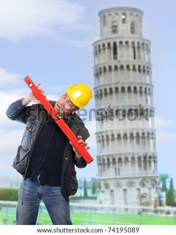 Funny picture of worried builder using a spirit level against  leaning tower of Pisa.