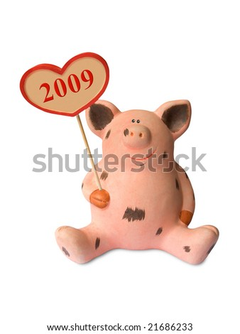 Funny pig with heart 2009 isolated on white background