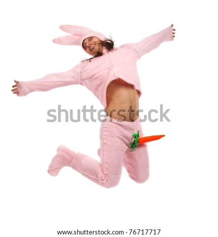 Funny pink rabbit jumping on white background