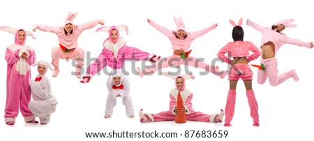 Funny pink rabbits have a fun isolated on white background