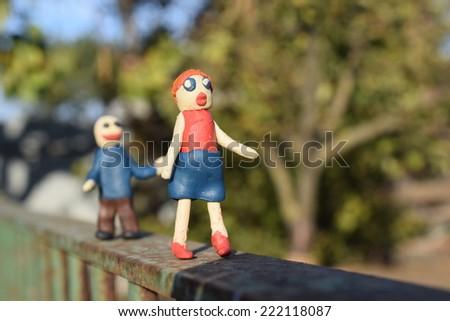 Funny plasticine man runs for plasticine girl