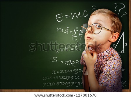 Funny portrait clever pupil boy on school board background