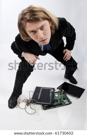 Funny portrait of a businessman with broken laptop, image taken with fish eye lens, in studio