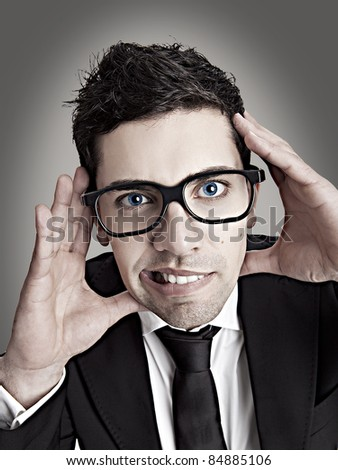 Funny portrait of a young businessman with a nerd glasses - stock photo