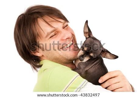 Funny portrait of a young man holding a cute chihuahua dog