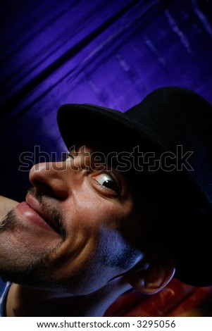 Funny portrait of a young man in cylinder hat