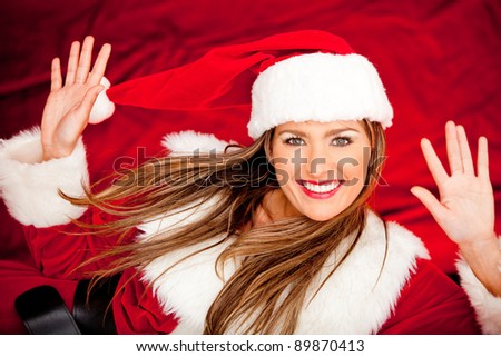 Funny portrait of female Santa smiling ? isolated over a white background