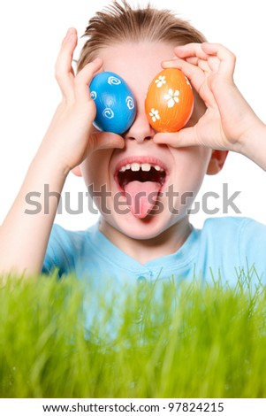Funny portrait of happy boy holding Easter eggs
