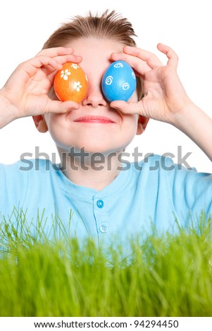 Funny portrait of happy boy playing with Easter eggs
