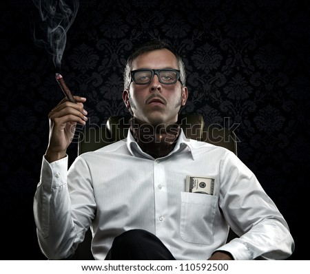 Funny portrait of rich man with serious face expression smoking a cigar