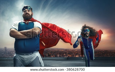 Funny portrait of two antagonistic super heroes