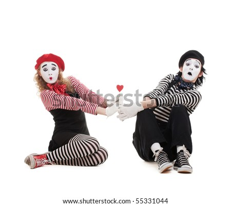 funny portrait of two mimes with red heart. isolated on white background