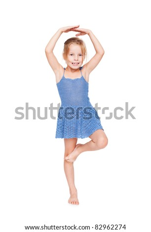 funny pretty little girl in blue dress isolated on white background.