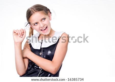 Funny pretty schoolgirl with pen scratching head