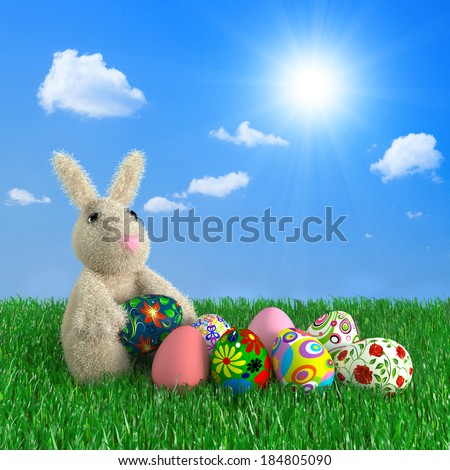Funny rabbit with Easter eggs on a green grass. #184805090
