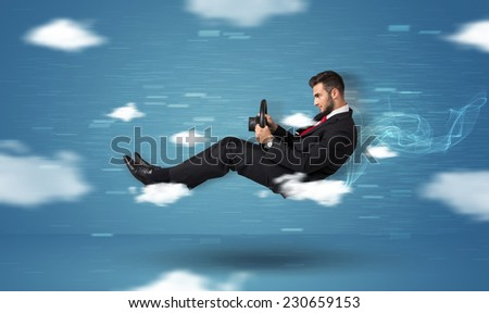 Funny race driver young man driving between clouds concept on blue background