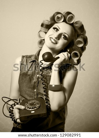 Funny retro girl talking on phone.Fun concept.Pin-up style.Isolated on white