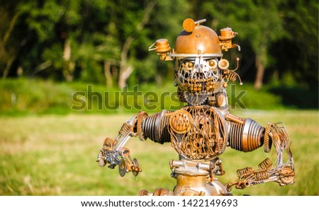 Funny robot on nature background. Robot portrait. Funny robot cyborg. Robot face