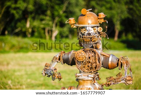 Funny robot on nature background. Robot portrait. Vintage robot