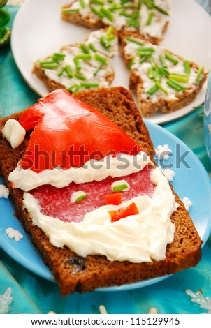 funny sandwich with santa claus as christmas breakfast for child