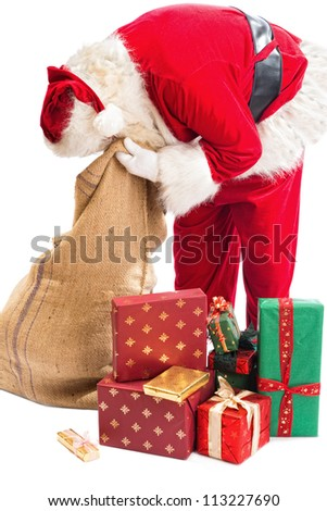 Funny Santa Claus desperately looking for a gift in his bag