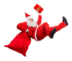 Funny Santa Claus falls with a bag full of x-mas gifts. Santa Claus rushing give gifts at Christmas. Falling Santa carry sack and gift box.