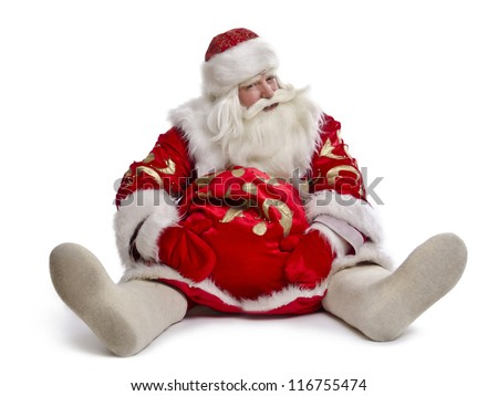 Funny Santa Claus sitting on the ground with a bag