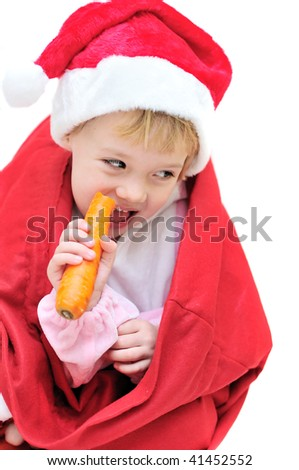 funny santa girl sitting in the bag and eating carrot