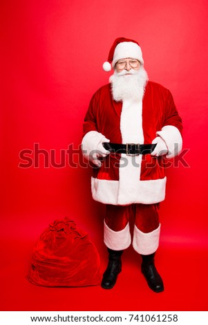 Funny santa in headwear, costume, white gloves brings a lot of gifts for kids, ready, prepared, sale promotion concept. Holly jolly x mas festive noel miracles and magic time! Bag on the floor #741061258