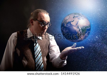 Funny scientist looking to universe and planet earth #1414491926