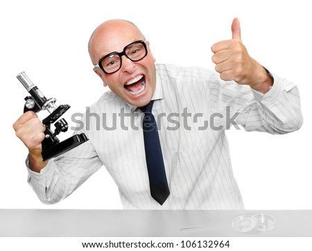 Funny scientist with microscope celebrating his new invention.