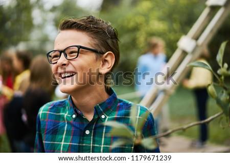Funny smiling laugh boy green shirt lifestyle park portrait pupil school
