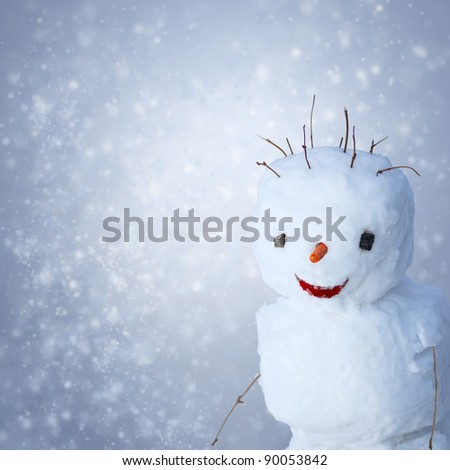 Funny Snowman with carrot and sticks under snowy background
