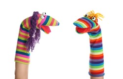 Funny sock puppets for show on hands against white background
