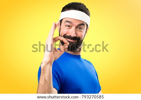Funny sportsman making OK sign on colorful background