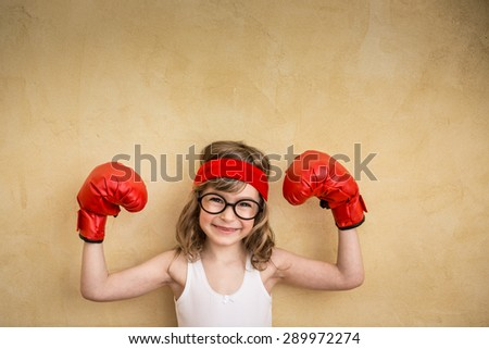Funny strong child. Girl power and feminism concept #289972274