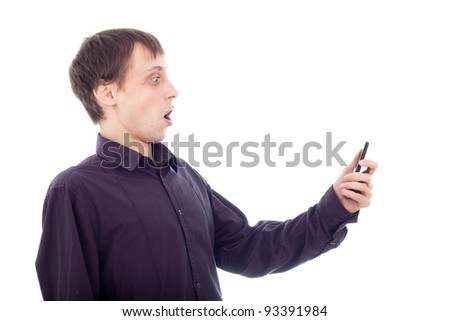 Funny surprised nerd man looking at cellphone, isolated on white background.
