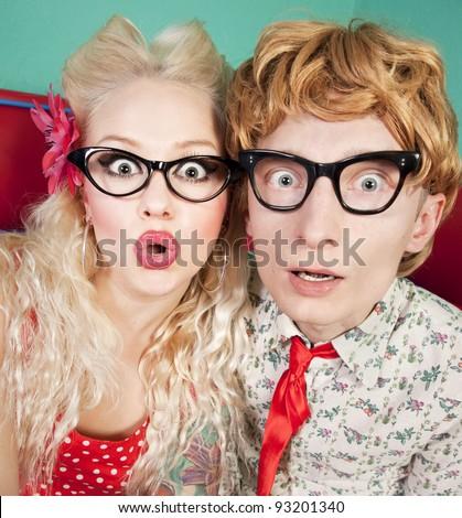 Funny surprised nerdy couple - stock photo