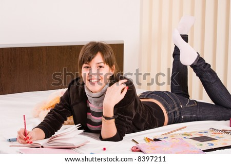 funny teenage girl writing in her diary
