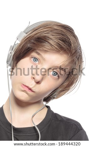 funny teenager boy with earphones, isolated on white.