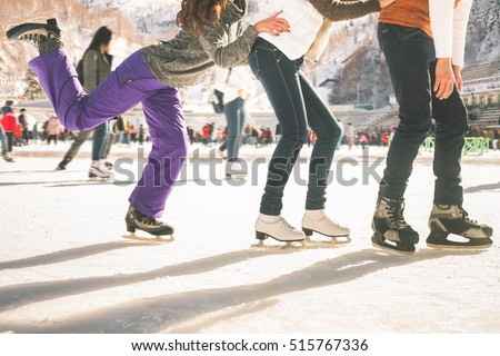 Funny teenagers girls and boy skating outdoor, ice rink - Shutterstock ID 515767336