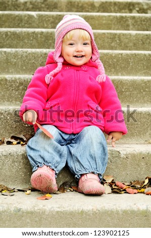 funny toddler sitting on the stairs