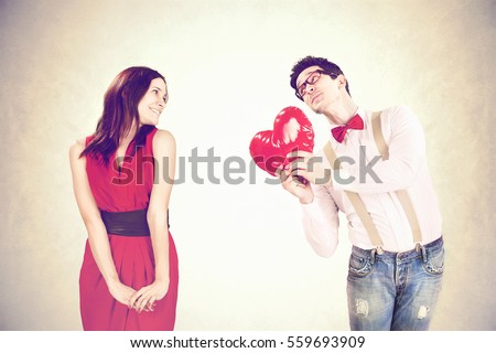 Shutterstock Funny Valentine's Day,romantic boy gives a heart to his girlfriend