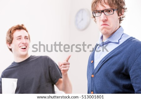 funny version of a scene in which an office worker makes fun of his very disappointed colleague