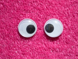 Funny Wiggle Google Eyes on Fabric Silly Pink Fur Carpet Background