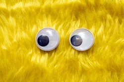 Funny Wiggle Google Eyes on Fabric Silly Yellow Furry Background